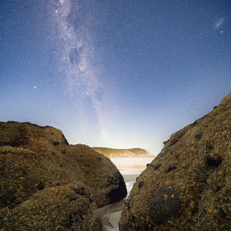 Peeking through the boulders at the night sky over Wilsons Prom